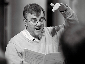 Malcolm Archer directing choral singers